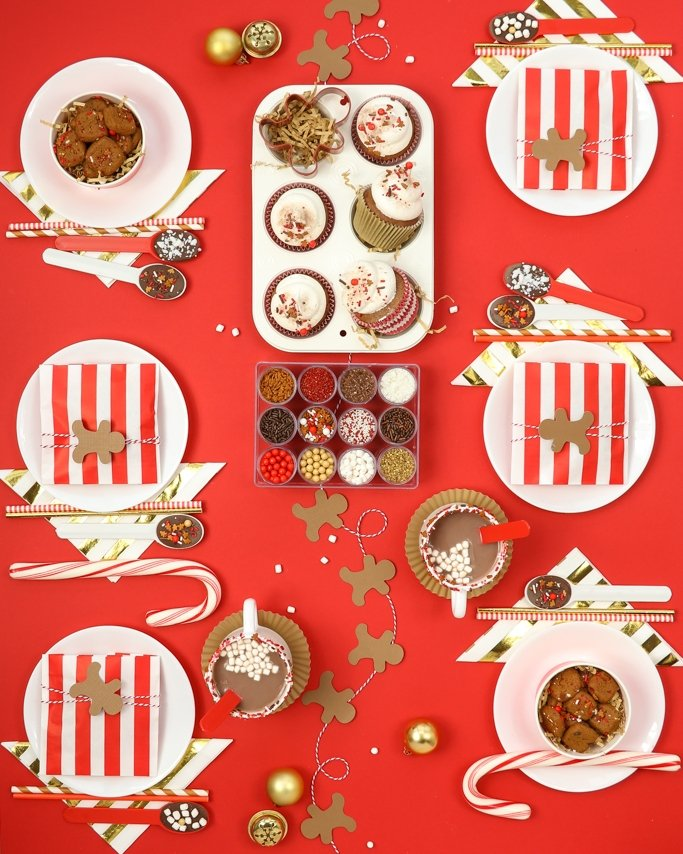Cocoa & Cookies Christmas Party Ideas - 6 place setting with red and gold Christmas party supplies on red background