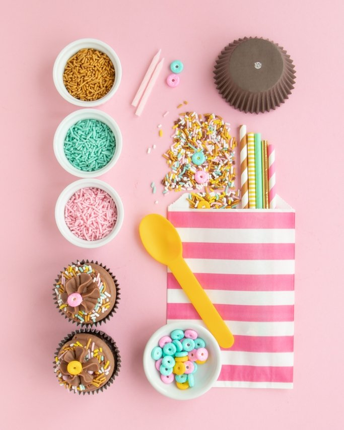 Donut Party Supplies collage with cupcakes, donut sprinkles, and other donut party supplies