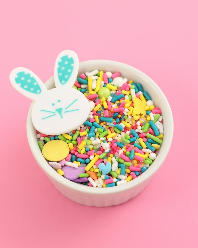 Easter Basket Sprinkle Mix - Easter Sprinkles with bunny ring on light pink background