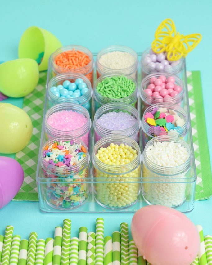 Easter Sprinkle Mix Kit Box in plastic containers on light blue background