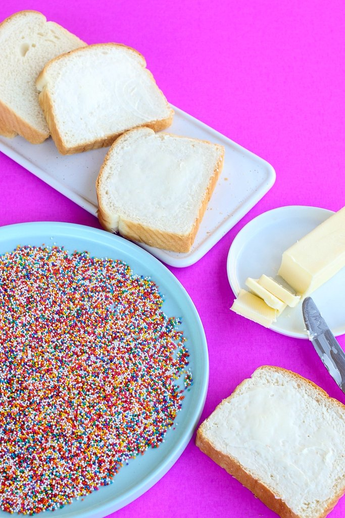Colorful nonpareil sprinkles and bread and butter to make Fairy Bread.
