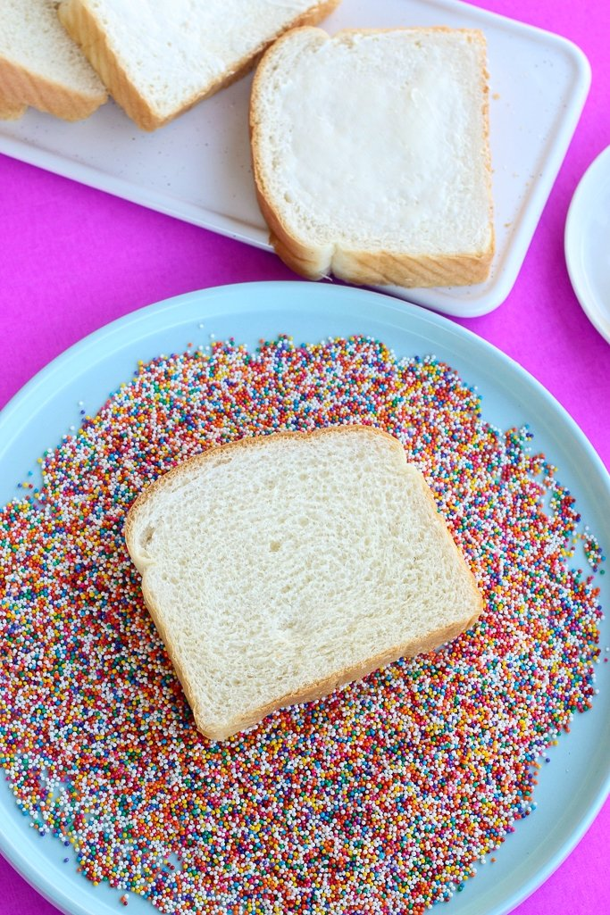 Plate of nonpareil sprinkles used for traditional fairy bread recipes