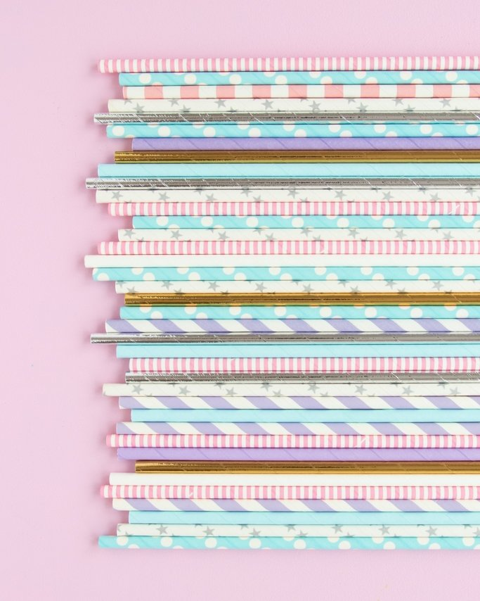 Unicorn Party Paper Straws assorted on light purple background