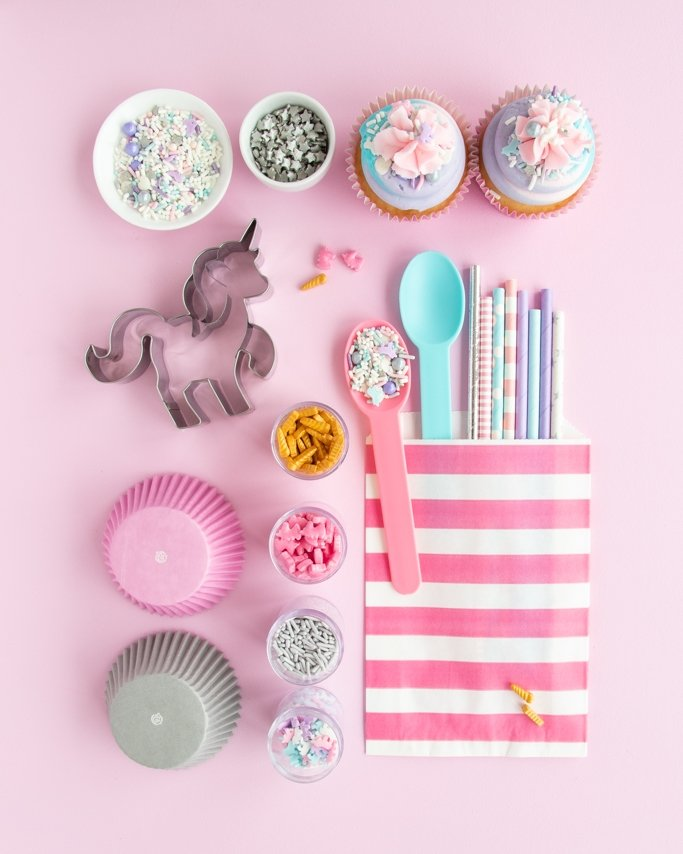 Unicorn Party Supplies collage with unicorn sprinkles on light pink background