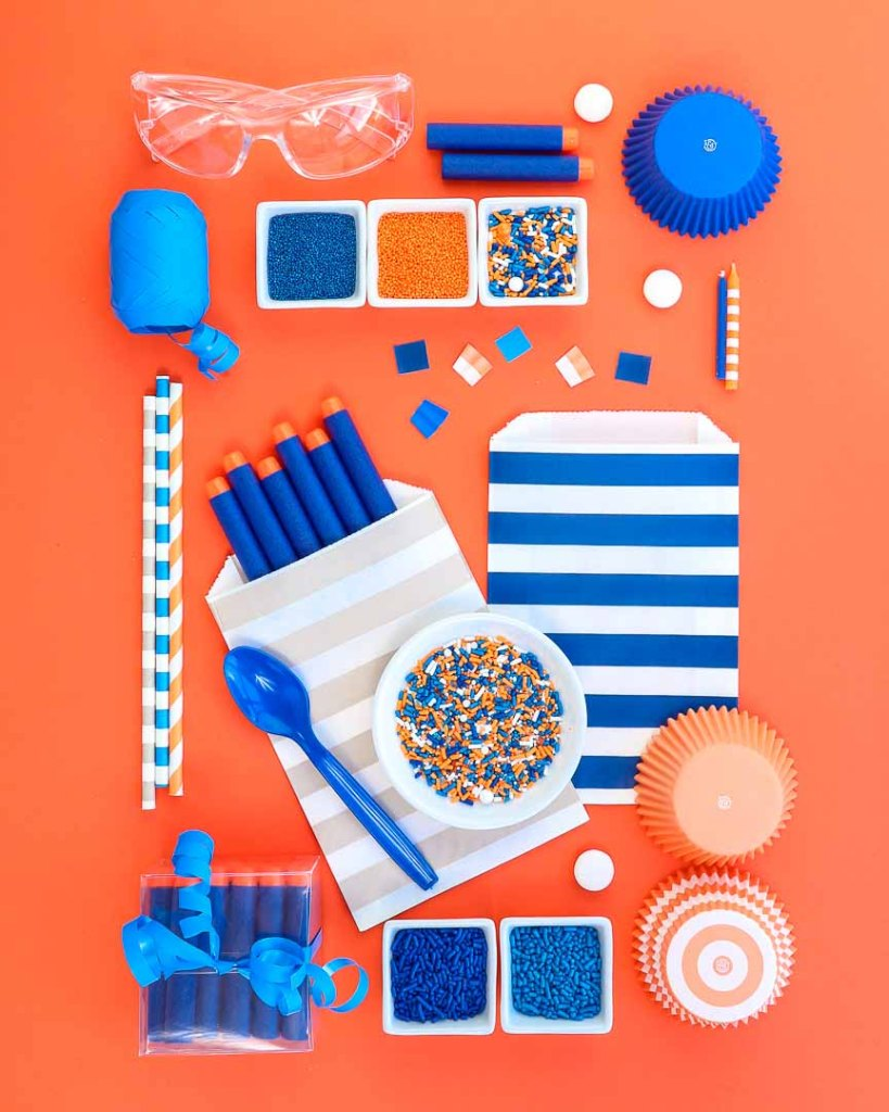 Nerf party ideas board - Nerf Party Supplies all on orange background