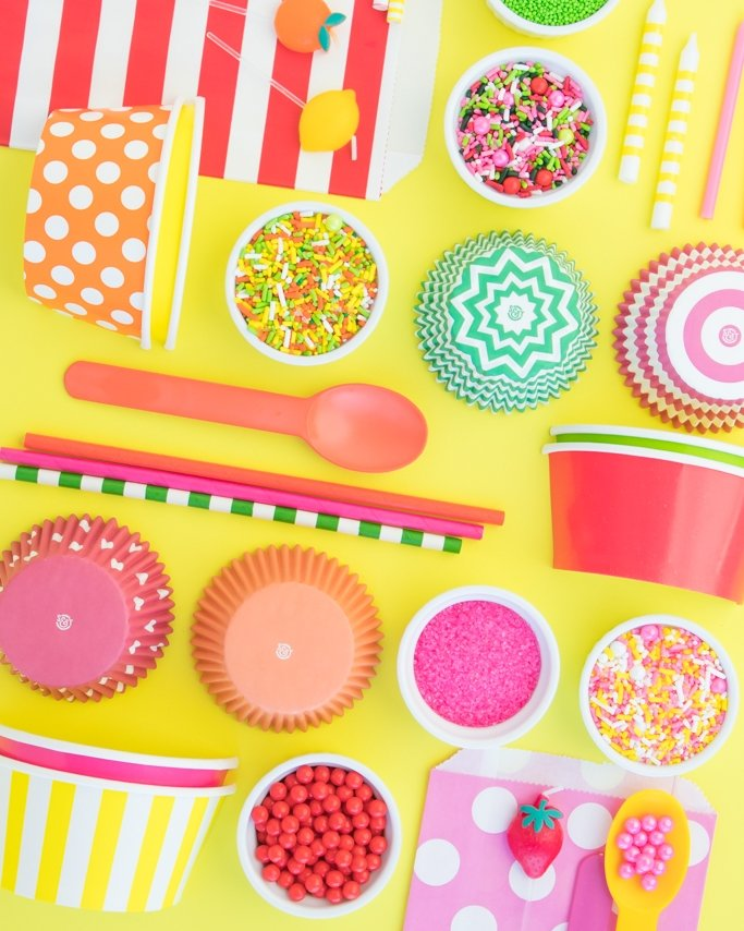 Summer party ideas, fruit party ideas - fruit party supplies laid out on bright yellow background