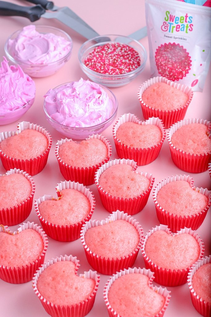 After the heart cupcakes are removed from the baking pan we can add frosting and decorations