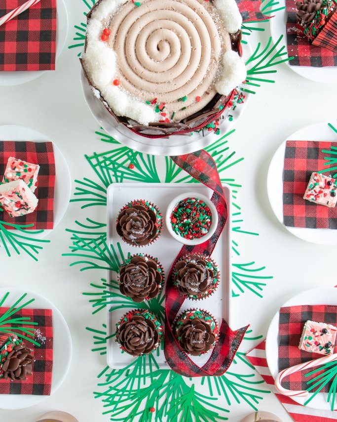 closeup overhead photo of our lumberjack party table with buffalo plaid party supplies