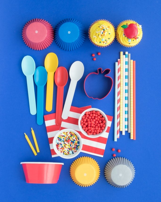 Snow White Party Supplies on blue background in assorted grid pattern