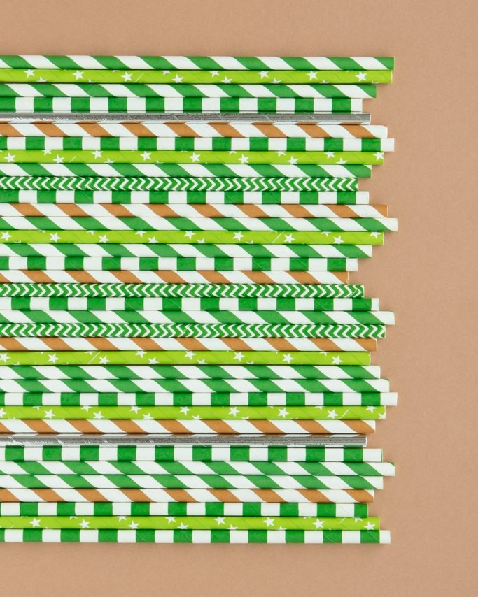 camo party paper straws laying on brown background