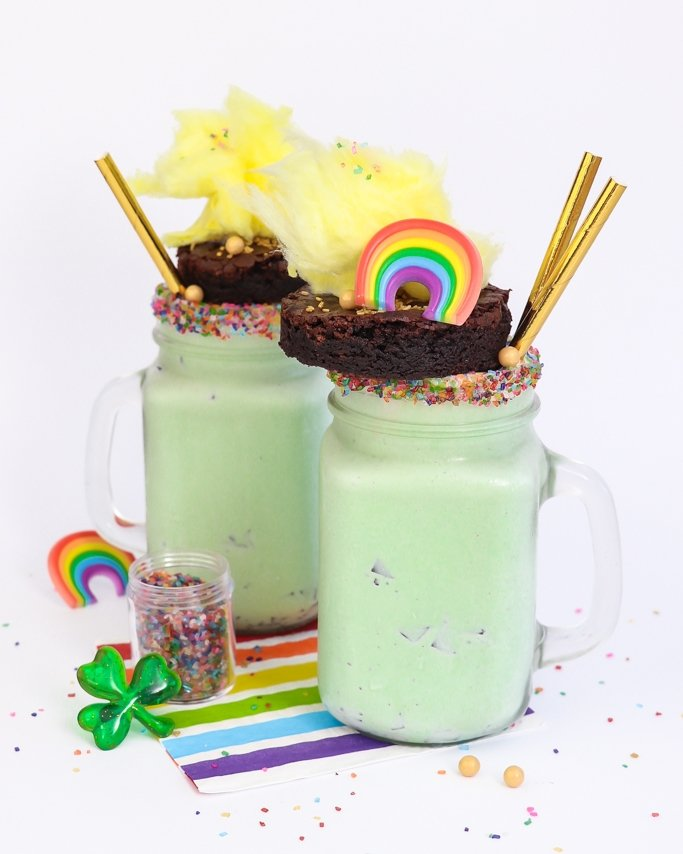 Two mint freakshakes on table of sprinkles