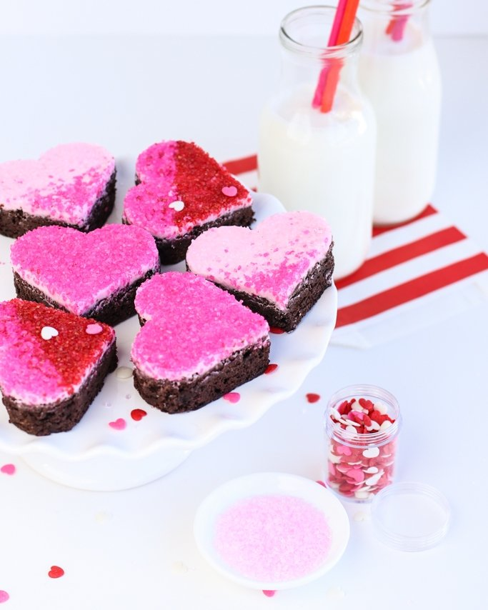 sugar crystal covered heart valentine brownies on cake stand with milk