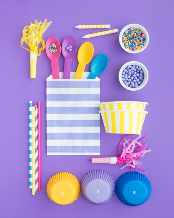 Shimmer and Shine Party Supplies on purple background