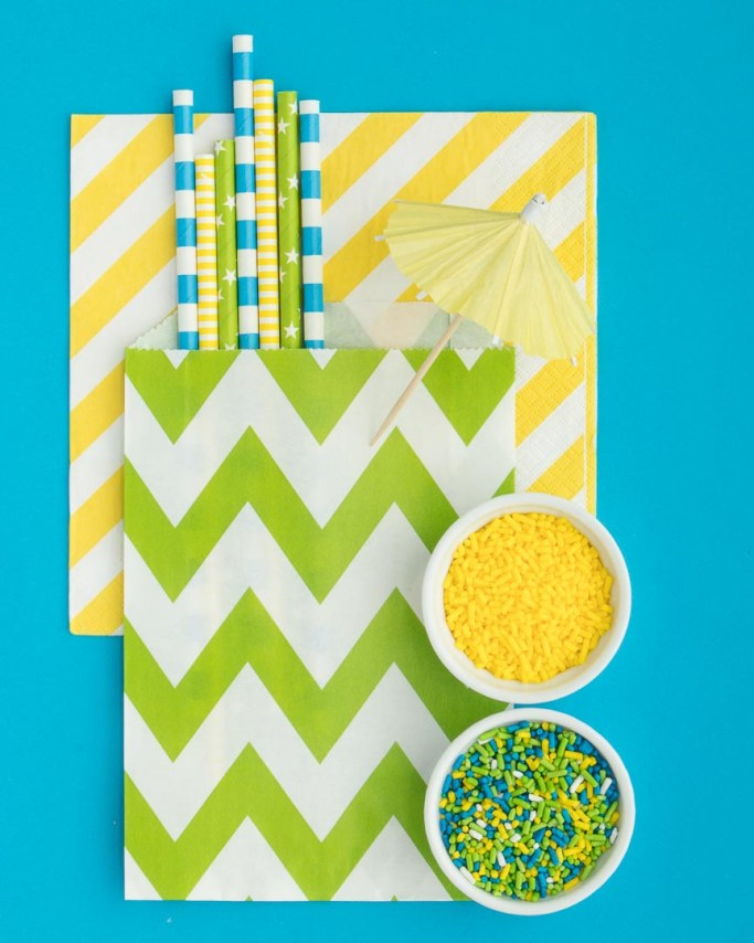 Pool Party Paper Straws with drink umbrella on blue background