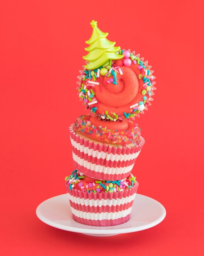 Stacked Christmas cupcakes on white black and red background