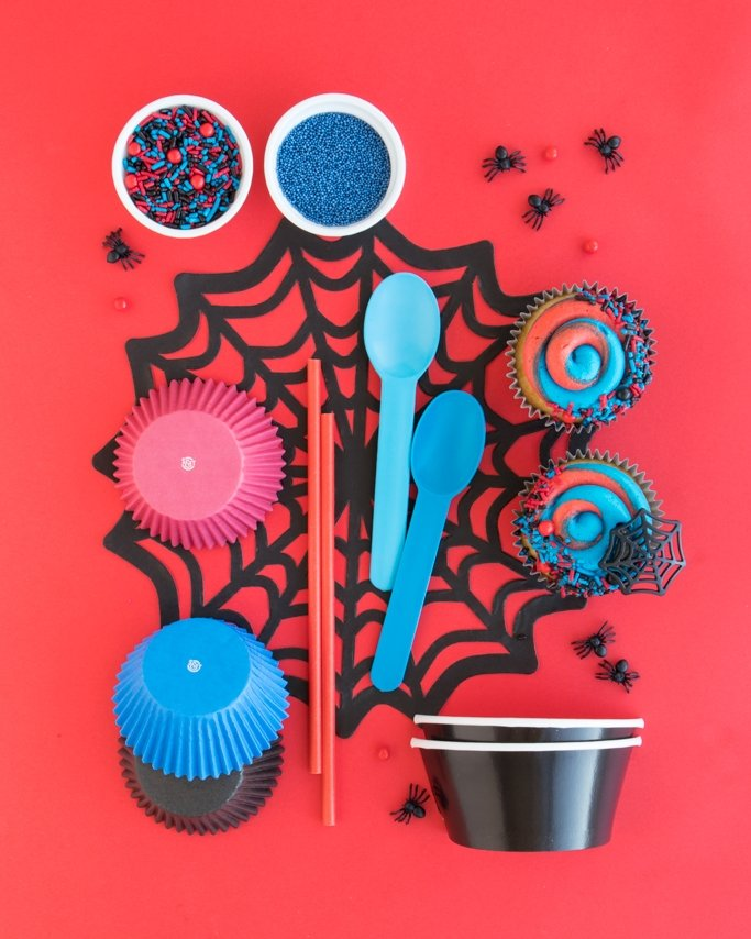 Spiderman Party Supplies collage on black spider web and red background