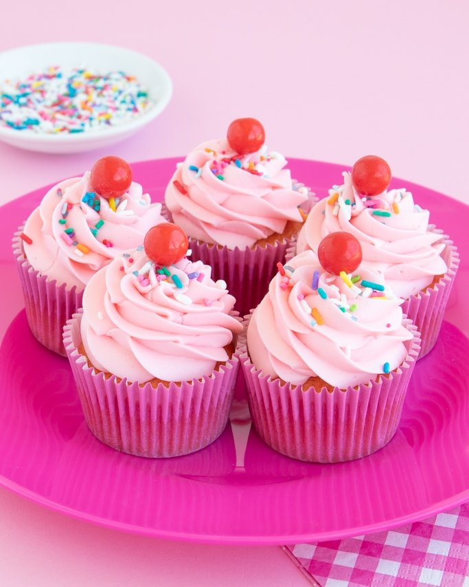 strawberry funfetti cupcakes on pink plate