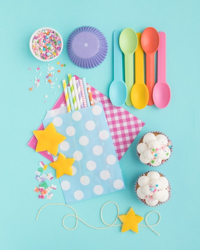 Rainbow Party Supplies and Pajama Party Supplies, cloud cupcakes, star cookies, presented on a blue background