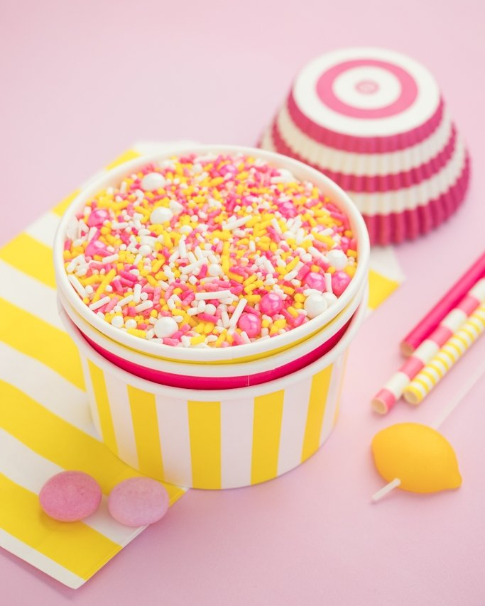 Pink Lemonade Party Sprinkles - Pink and yellow jimmies, sugar crystals and more in a yellow stripe ice cream cup