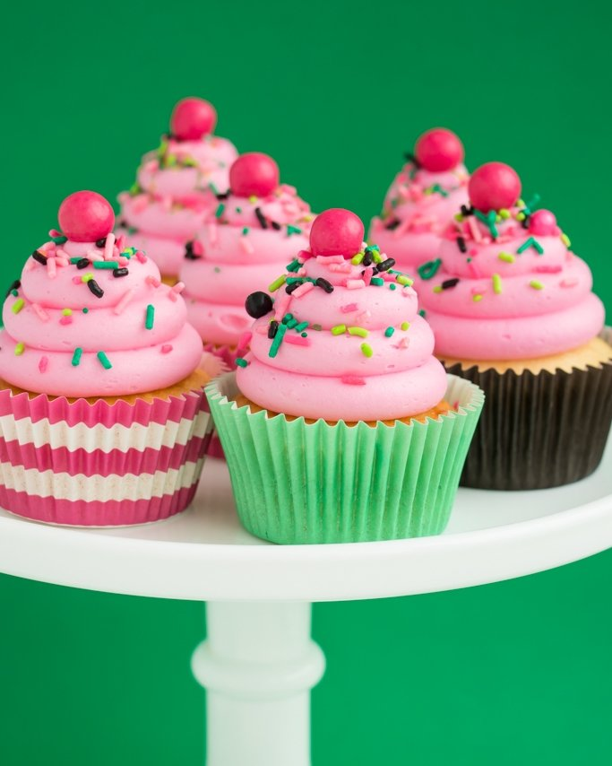Watermelon cupcakes with watermelon sprinkles.