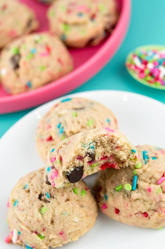 Yummy Sprinkle Cookies! Thick & chewy chocolate chip cookies filled with festive sprinkles -- perfect for any occasion!