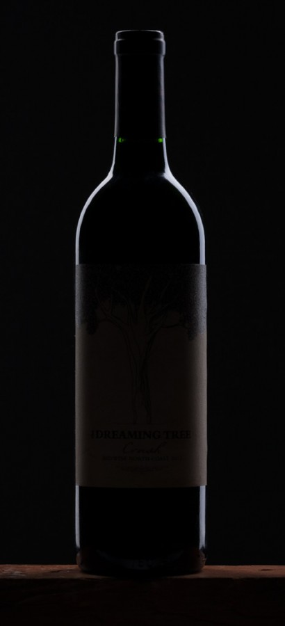 © 2013 Kevin Ames | Photographing a red wine bottle presents a few lighting challenges. The first is to define the shape of the bottle itself. It is really a very shiny almost black mirror. Lighting dark, reflective objects is simply adding the highlights that will define its shape.