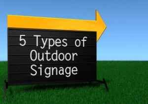Outdoor sign with large orange arrow