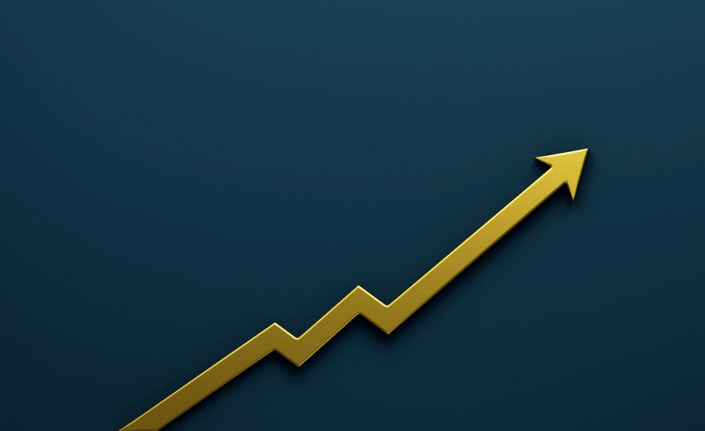 A yellow arrow showing improvement going up and to the right on a blue background.