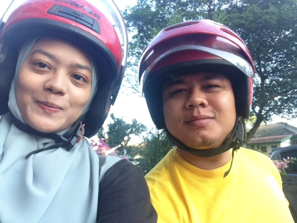 Maryam and Fadzel on their 16-year-old motorcycle.