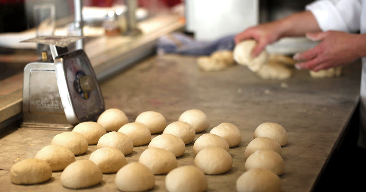 Rolls of dough lined up ready for production