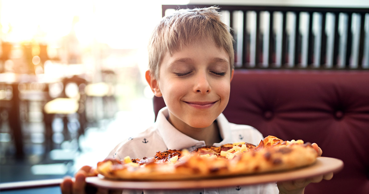 Happy Child with Pizza