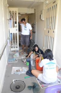 Students getting down to work at one of the houses during Community Homeworks 2013.