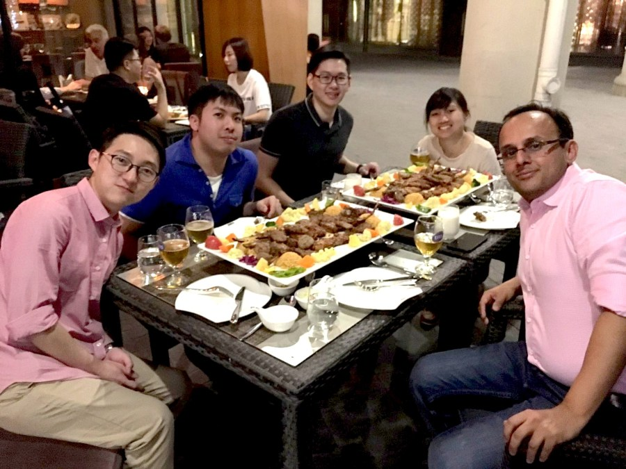 Leon Gim having dinner with Assoc. Prof. Kapil R. Tuli and PhD colleagues.