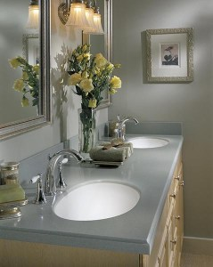 Design a Corian® custom solid surface vanity top with dual sinks.
