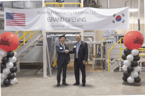 Jung Seok Yoo, left, chief executive officer of Hyundai L&C USA, shakes hands with Wilsonart chief executive officer Tim O'Brien at the new American Surfacing Materials manufacturing plant in Temple.