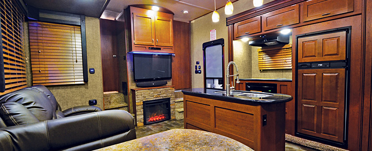 Wood cabinets with solid surface countertops in a recreational vehicle.