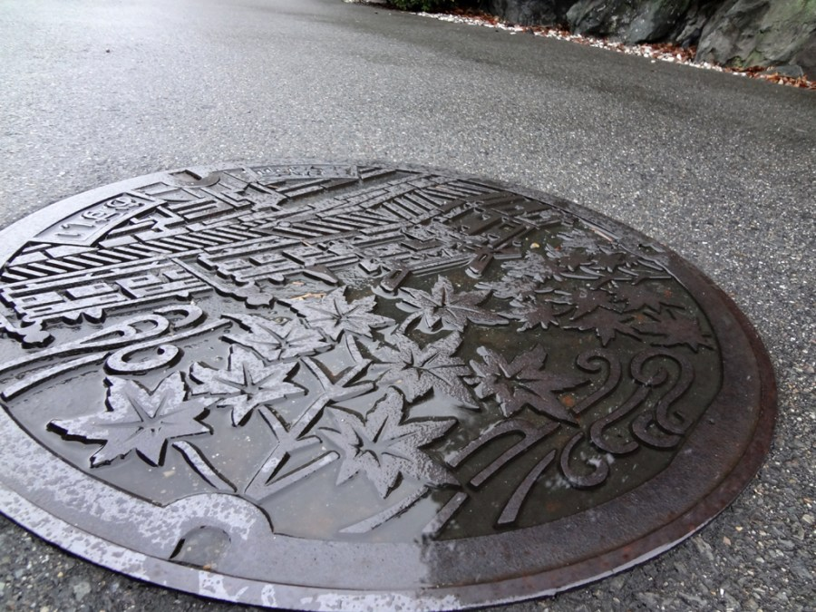 A rainy manhole cover in Kyoto