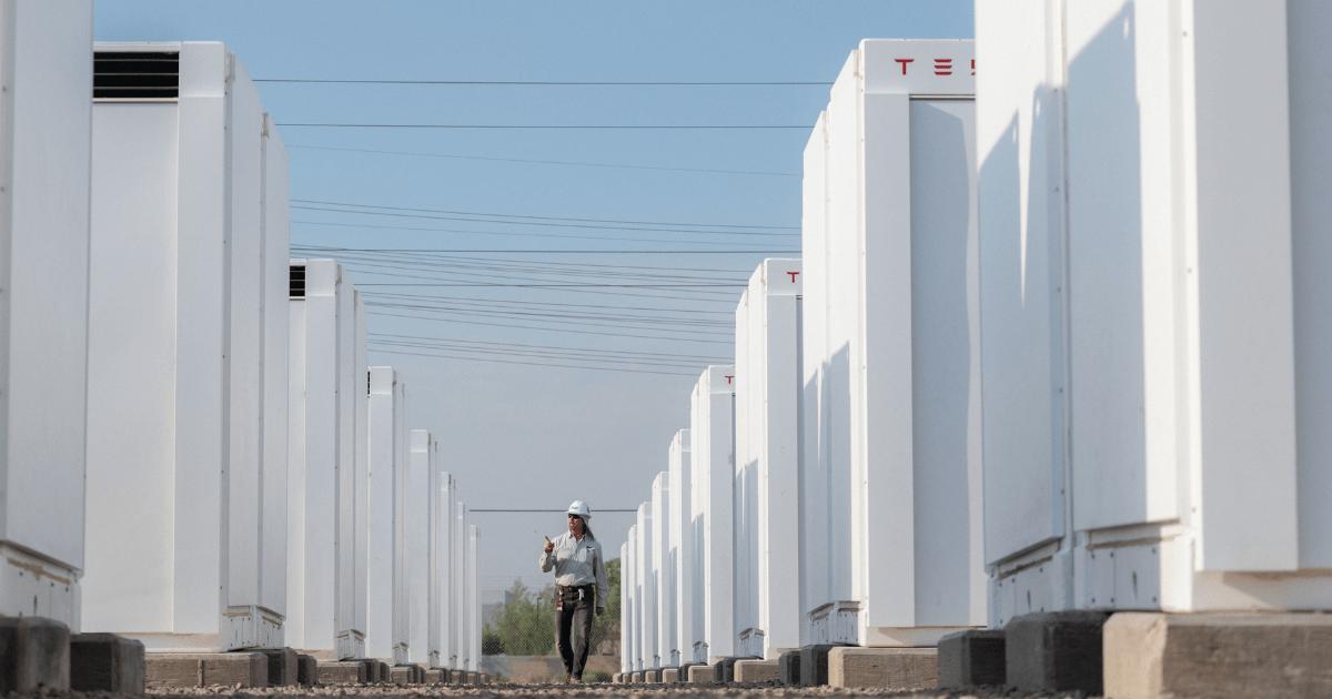 employee-walking-through-tesla-megapack-battery-storage-facility