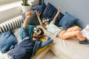 A father and daughter using VR