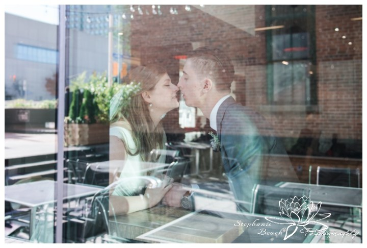 Ottawa-Fall-Wedding-Stephanie-Beach-Photography-bride-groom-novotel-hotel-window-90s-rom-com