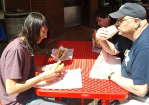 The Native American boys and their teacher enjoy a genuine Philly Cheesesteak.