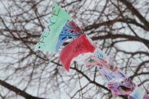 Prayer flags originated in Tibet and are now displayed at St. Joseph's Indian School.