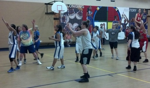 St. Joseph's eighth grade girls matched up against staff for a basketball game.