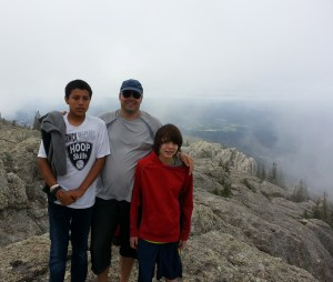 Odis, a houseparent, accompanied students in the summer home on a trip to the Black Hills and Harney Peak.