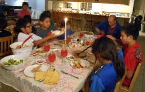 "A ""fancy"" dinner including toasts and candle light helped the boys learn good manners."