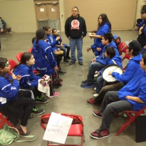 Lakota hand games teams have up to 10 players each.