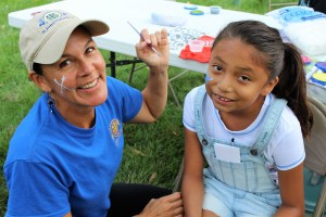 A Native American student gets her face painted during the Back-to-School Picnic at St. Joseph's Indian School.
