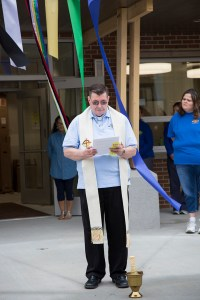 Fr. Anthony prays for Health and Family Services Center at St. Joseph's