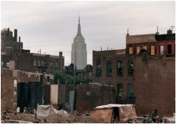 Photo: Run Down Buildings With a View of the Empire State Building Off in the Distance