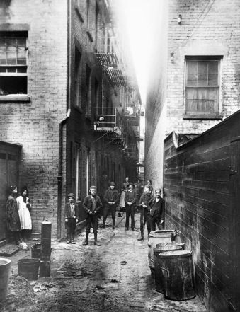 Photo: Children in Mullens Alley off Cherry Street, New York City, 1888, by Jacob Riis